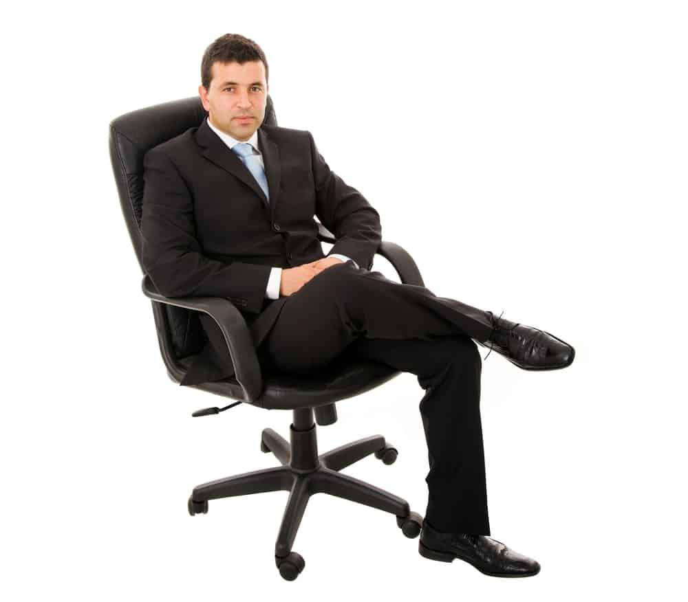 a businessman on an office chair