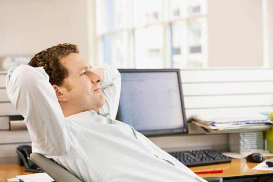 young man recline on office chair