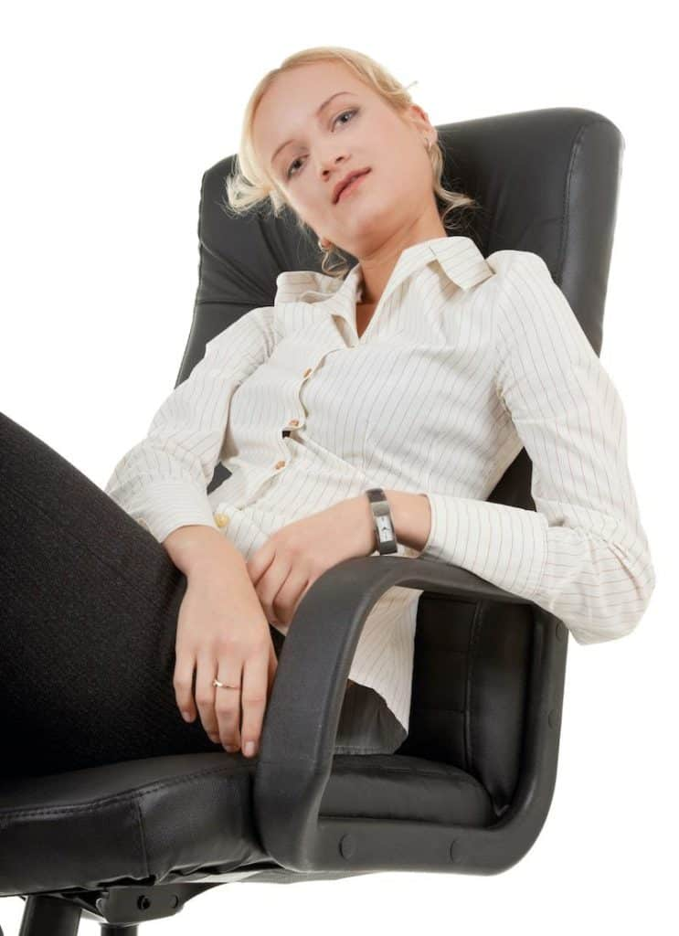 a young lady slouching on an office chair