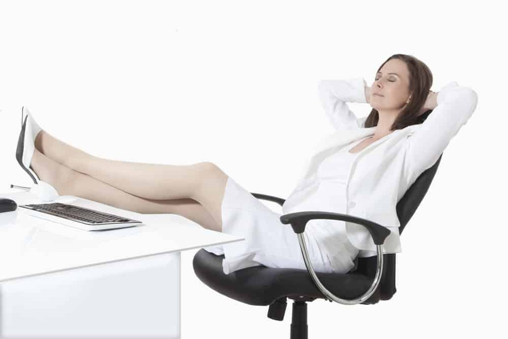 businesswoman taking a nap on reclining office chair