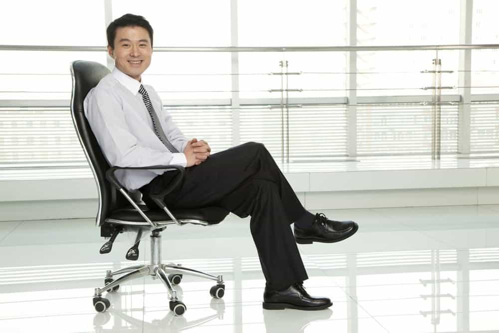 businessman sitting in standard office chair
