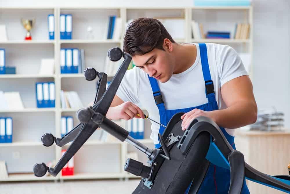 man repair and assemble an office chair