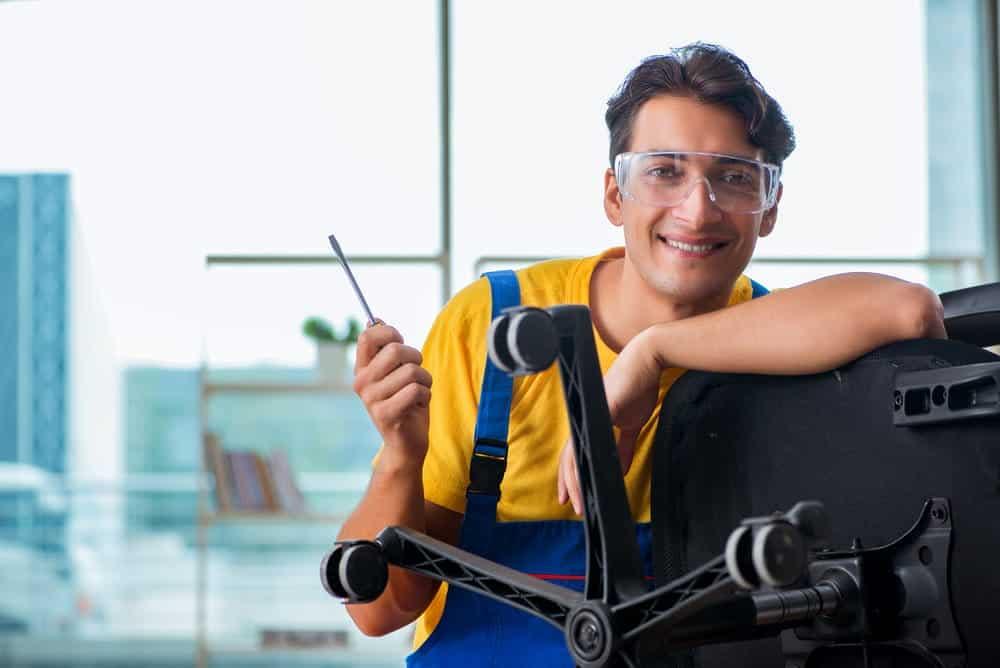 man repair broken office chair arms