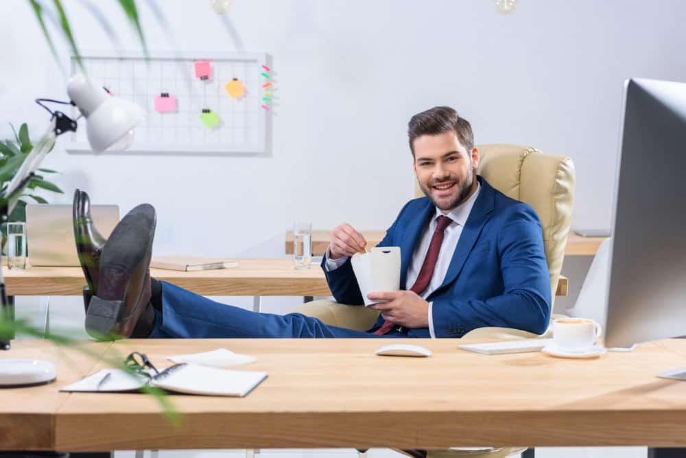 man takes a break on a La-Z-Boy office chair