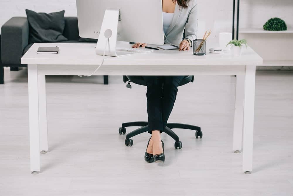 using adjustable leg levers to make desk higher