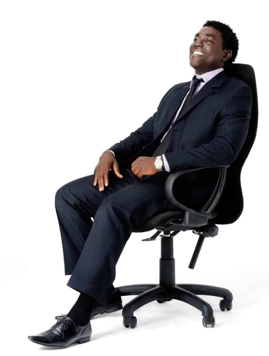 black businessman sitting in high back office chair