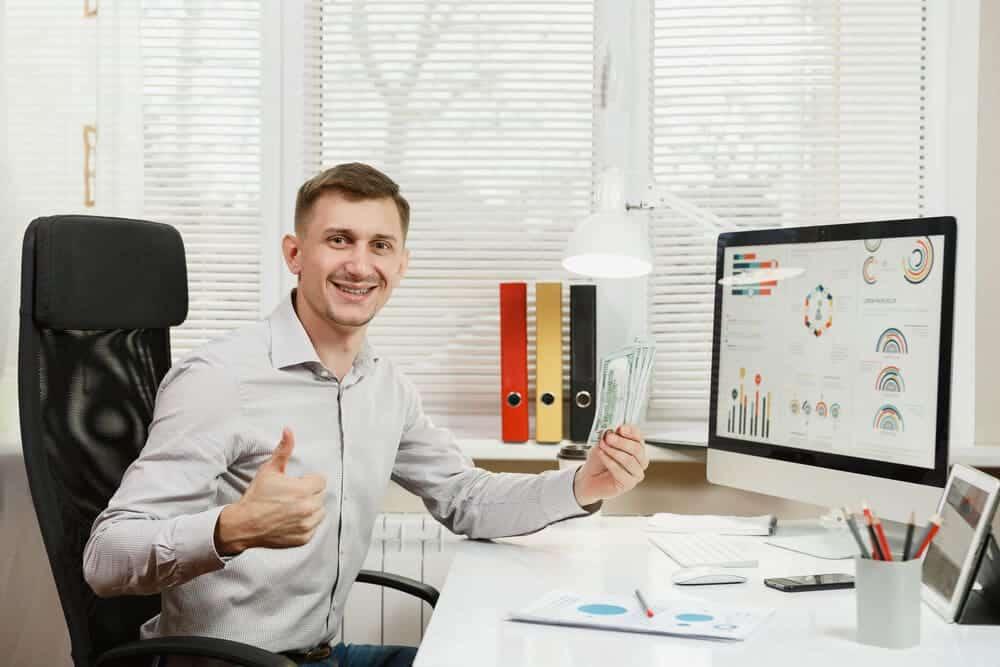 businessman sitting in IKEA Markus office chair