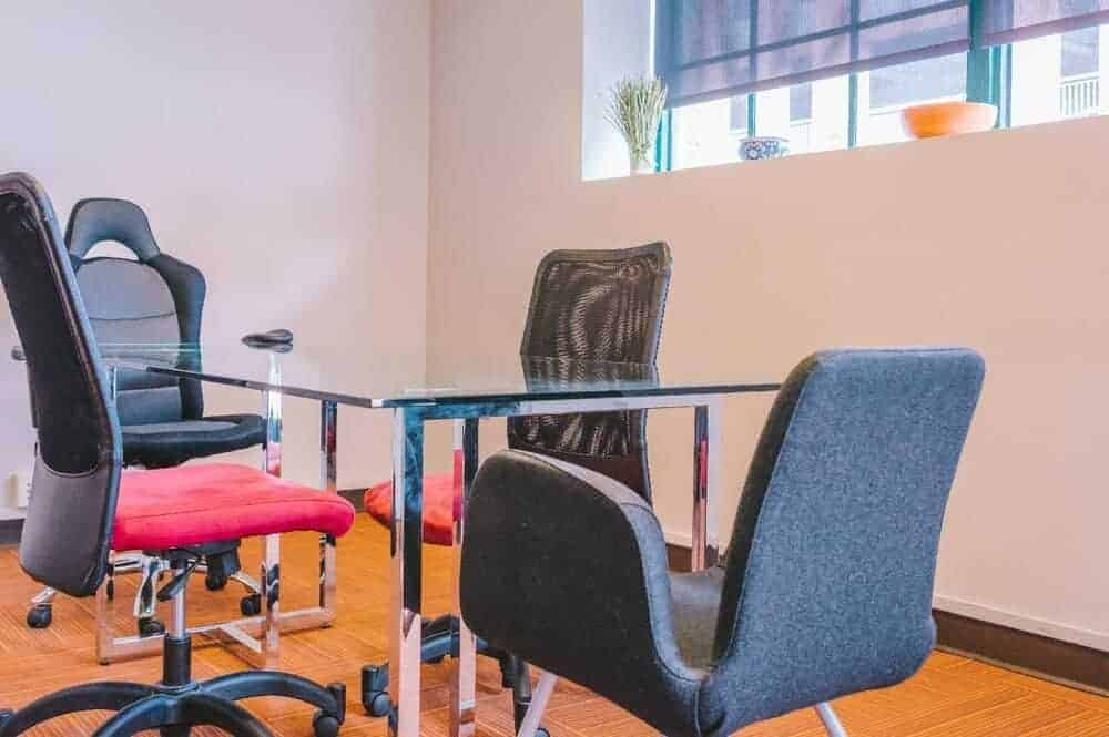 mesh and leather office chairs in a room